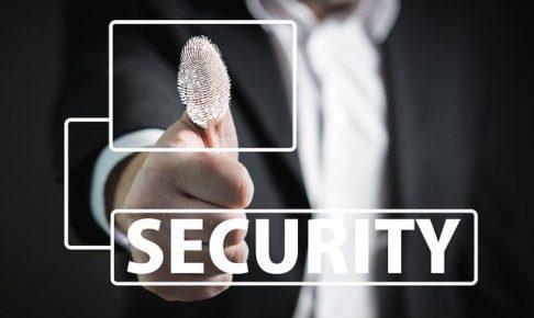 指紋を押すビジネスマンとSECURITYという文字